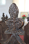 Church of Saint Andrew, Monewden, Suffolk, England, UK  1480 carved wooden bench end lilies representing Virgin Mary