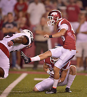 STAFF PHOTO BEN GOFF  @NWABenGoff -- 09/20/14 <br /> Arkansas kicker John Henson makes a successful extra point with holder Matt Emrich during the fourth quarter of the game against Northern Illinois in Reynolds Razorback Stadium in Fayetteville on Saturday September 20, 2014.