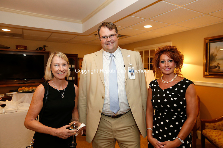 Waterbury, CT- 27 August 2015-082715CM07- Social moments from left, Jan Kennedy with Cardiology Associates of Greater Waterbury, Chad Chad W. Wable, President and Chief Executive Officer, Saint Mary's Hospital and Gina Goldstein with Athena Healthcare of Waterbury are photographed during a 10th anniversary celebration of the Heart Center of Greater Waterbury at The Village at East Farms, in Waterbury on Thursday.  Christopher Massa Republican-American