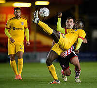 Northampton Town's Aaron Pierre under pressure from Lincoln City's Matt Rhead<br /> <br /> Photographer Chris Vaughan/CameraSport<br /> <br /> Emirates FA Cup First Round - Lincoln City v Northampton Town - Saturday 10th November 2018 - Sincil Bank - Lincoln<br />  <br /> World Copyright © 2018 CameraSport. All rights reserved. 43 Linden Ave. Countesthorpe. Leicester. England. LE8 5PG - Tel: +44 (0) 116 277 4147 - admin@camerasport.com - www.camerasport.com
