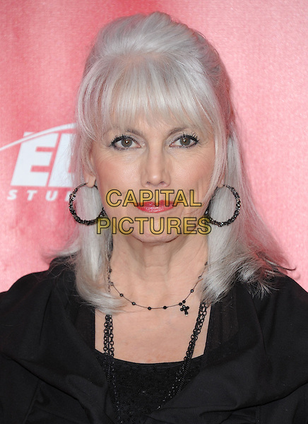 Emmylou Harris.The MusiCares 2013 Person Of The Year Tribute held at The Los Angeles Convention Center, West Hall in Los Angeles, California, USA..February 8th, 2013.headshot portrait hoop earrings black  .CAP/RKE/DVS.©DVS/RockinExposures/Capital Pictures.