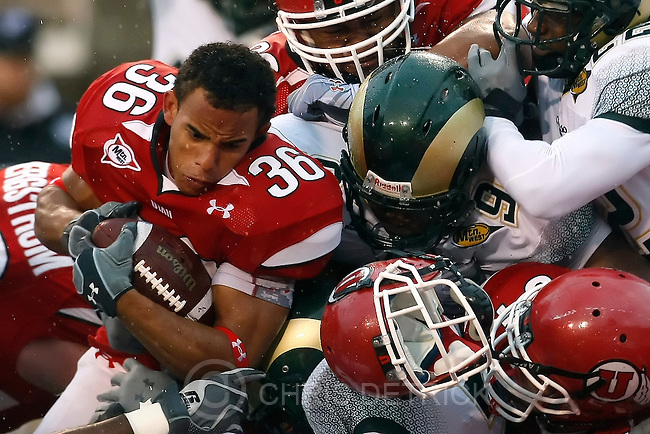 Chris Detrick  |  The Salt Lake Tribune .Utah Utes running back Eddie Wide #36 has his helmet knocked off by Colorado State Rams cornerback Ivory Herd #35 and Colorado State Rams defensive end C.J. James #9 during the first half of the game at Rice-Eccles Stadium Saturday October 23, 2010.  The Utes are winning the game 24-6.
