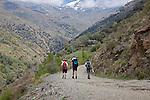 People walking Poqueira gorge valley, High Alpujarras, Sierra Nevada, Granada Province, Spain