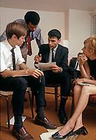 Ralph Nader talking with members of his staff, Washington DC, 1969. Photo by John G. Zimmerman.