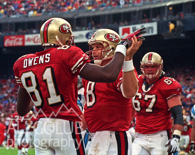 San Francisco 49ers vs. Carolina Panthers at Candlestick Park Sunday, November 16, 1997.  49ers beat Panthers  27-19.  San Francisco 49ers quarterback Steve Young (8) and wide receiver Terrell Owens (81) celebrate touchdown.