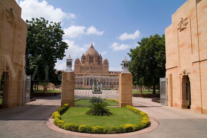 Entrance to the historic Umaid Bhawan Palace in Jodhpur, Rajasthan, India which is now primarily a hotel where visitors and Raj with Queen now stay.