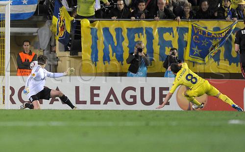 17.03.2011 Santi Cazorla of Villarreal (R) scores the 1-0 lead past Leverkusen's goalkeeper Rene Adler during the Europa League round of 16 first second soccer match between Bayer Leverkusen and Villarreal C.F. at the Al Madrigal Stadium