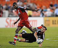 DC United midfielder Chris Pontius (13) gets fouled by Toronto FC defender Andy Iro (3) DC United tied Toronto FC 3-3 at RFK Stadium, Saturday August 6 , 2011.
