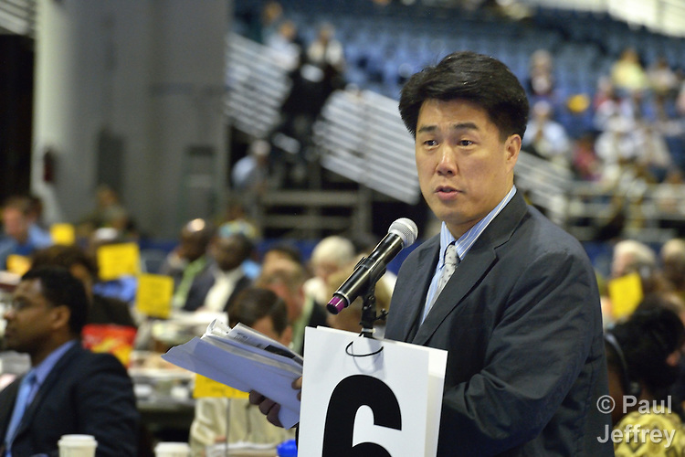 The Rev. We Hyun Chang, a pastor in Belmont, Mass., and a delegate from the New England annual conference, argues on May 1 for retaining guaranteed appointments for clergy, during a debate at the 2012 United Methodist General Conference in Tampa, Florida. The guarantee of an annual appointment was eliminated by the conference.