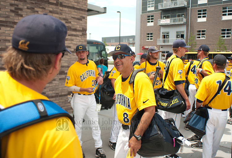 "17 June 2011  -- David Esquer California Berkeley Baseball. University of California Berkeley baseball coach David Esquer with his team after getting a team portrait in front of the ""Road to Omaha"" statue   during opening day celebrations on Friday, June 17 at TD Ameritrade Park Omaha for the College World Series in Omaha, Nebraska. PHOTO/Daniel Johnson (Copyright 2011 Daniel Johnson)"