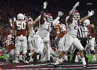 Arkansas Democrat-Gazette/BENJAMIN KRAIN --12/29/14--<br /> The Razorback defense celebrates a touchdown after Texas quarterback Tyrone Swoopes fumbled in the endzone during the 2nd quarter in the Texas Bowl Monday night at NRG Stadium in Houston.
