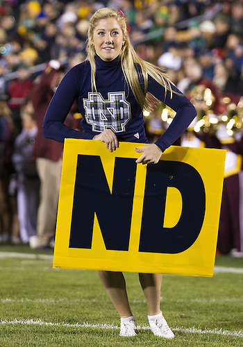 October 19, 2013:  Notre Dame cheerleader performs during NCAA Football game action between the Notre Dame Fighting Irish and the USC Trojans at Notre Dame Stadium in South Bend, Indiana.  Notre Dame defeated USC 14-10.