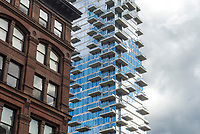 "New York, USA The 60 story condo, 54 Leonard Streed, known as the Jenga Building, rises above loft and industrial buildings in TriBeCa. Architects Herzog & de Meuron describes the building as ""houses stacked in the sky. ©Stacy Walsh Rosenstock"