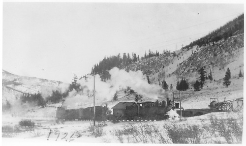 Two D&amp;RGW engines with a flanger plus a box car and a caboose at Monarch Mine.  The lead engine looks like a C-18.<br /> D&amp;RGW  Monarch, CO  12/1926