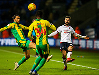 Bolton Wanderers' Luke Murphy crosses under pressure from West Bromwich Albion's Jay Rodriguez and Rekeem Harper<br /> <br /> Photographer Alex Dodd/CameraSport<br /> <br /> The EFL Sky Bet Championship - Bolton Wanderers v West Bromwich Albion - Monday 21st January 2019 - University of Bolton Stadium - Bolton<br /> <br /> World Copyright © 2019 CameraSport. All rights reserved. 43 Linden Ave. Countesthorpe. Leicester. England. LE8 5PG - Tel: +44 (0) 116 277 4147 - admin@camerasport.com - www.camerasport.com