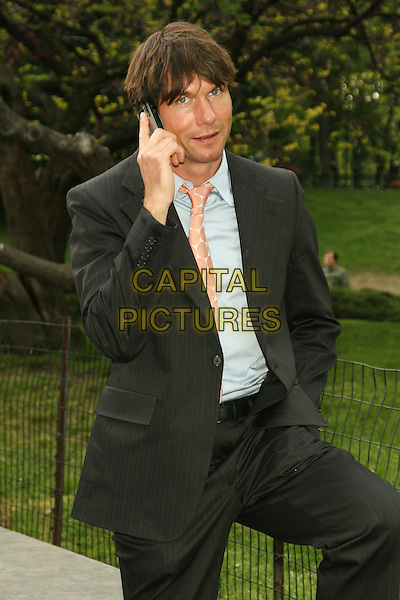JERRY O'CONNELL.2008 Fox Televison Network Upfront (programming presentation to advertisers) at Wollman Rink in Central Park, New York, NY, USA..May 15th, 2008.half length grey gray suit jacket blue shirt talking on mobile phone .CAP/LNC/TOM.©TOM/LNC/Capital Pictures.