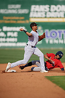 Jackson Generals second baseman Ramon Hernandez (12) throws to first base as Ray-Patrick Didder (13) slides in during a Southern League game against the Mississippi Braves on July 23, 2019 at The Ballpark at Jackson in Jackson, Tennessee.  Jackson defeated Mississippi 2-0 in the first game of a doubleheader.  (Mike Janes/Four Seam Images)