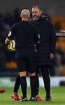 Nuno Santo manager of Wolverhampton Wanderers speaks to referee Mike Dean during the Premier League match at Molineux, Wolverhampton. Picture date: 14th February 2020. Picture credit should read: Darren Staples/Sportimage