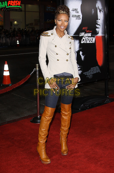 "EVA MARCILLE.Premiere Screening Of Overture Films' ""Law Abiding Citizen"" held At The Grauman Chinese Theatre, Hollywood, California, USA..October 6th, 2009.full length jeans denim tucked into brown thigh high boots beige cream white grey gray military jacket epaulettes gold buttons.CAP/ADM/KB.©Kevan Brooks/AdMedia/Capital Pictures."