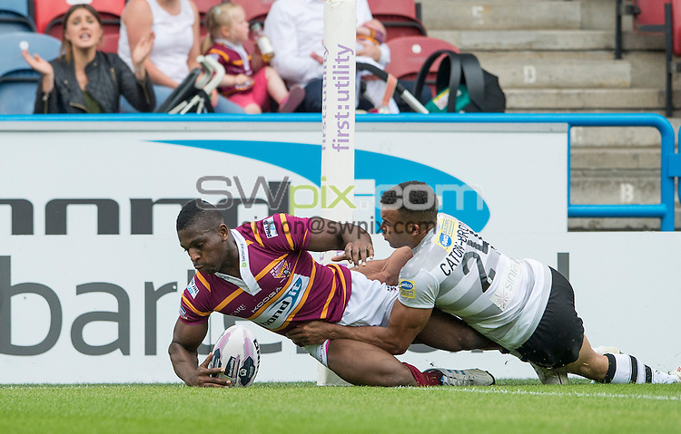 Picture by Allan McKenzie/SWpix.com - 21/06/2014 - Rugby League - First Utility Super League - Huddersfield Giants v London Broncos - John Smith's Stadium, Huddersfield, England - London's Mason Caton-Brown can't prevent Huddersfield's Jermaine McGillvary from scoring.