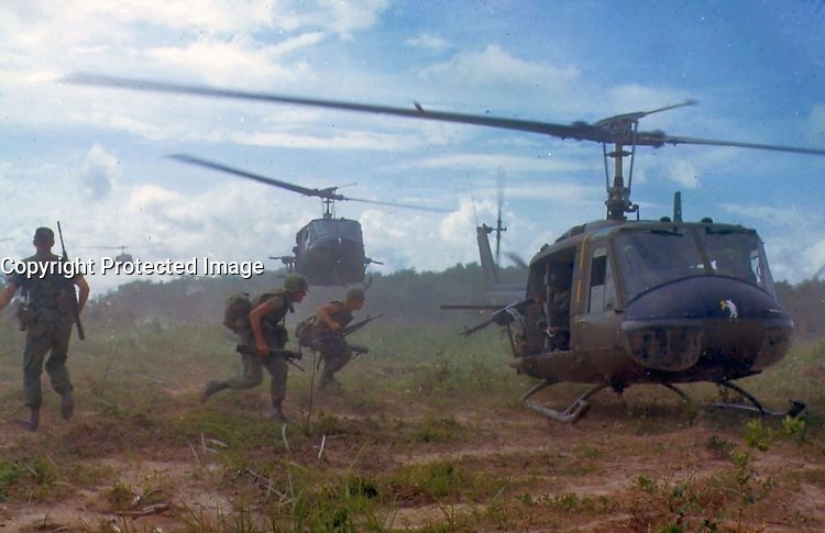 1966 File Photo - US soldiers run toward an UH-1D helicopter, in Vietnam