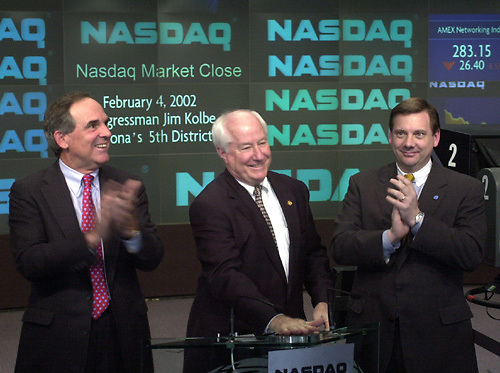 Nasdaq1/020702 -- The following photos are provided by Nasdaq and can be used by the media for free (with proper attributation). Steve Randich, VP Nasdaq Goverment Relations is on the Congressman's right. Wick Simmons, CEO and Chairman is to his left as Kolbe rings the bell...