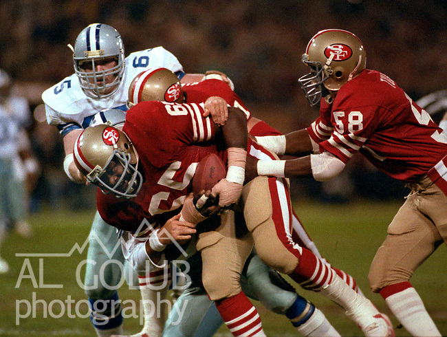 San Francisco 49ers vs. Dallas Cowboys at Candlestick Park Monday, December 19, 1983..49ers beat the Cowboys  42-17.San Francisco 49ers Defensive End Lawrence Pillers recovers fumble...