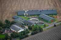 GERMANY aerial view of farm homestead with slurry tank, photovoltaic and wind turbine in Northern Germany  / DEUTSCHLAND, Luftaufnahmen von Solardaechern und Windkraftanlagen in Schleswig-Holstein, Hof von Kuddel Wind mit einer der ersten Windturbinen in Deutschland, hier Vestas Anlage, Solardaechern und Gülle tank