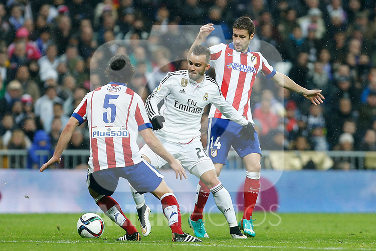 Real Madrid´s Jese Rodriguez (C) and Atletico de Madrid´s Gabi during Spanish King´s Cup match at Santiago Bernabeu stadium in Madrid, Spain. January 15, 2015. (ALTERPHOTOS/Victor Blanco)