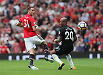 Manchester United's Nemanja Matic tussles with West Ham's Andre Ayew during the premier league match at Old Trafford Stadium, Manchester. Picture date 13th August 2017. Picture credit should read: David Klein/Sportimage