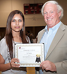 Iris Medina receives the Stan and Suzanne St. Pierre Scholarship Award. Presented by Stan St. Pierre at the 2011 Aldine Scholarship Foundation Scholarship Ceremony at Lone Star College - North Harris