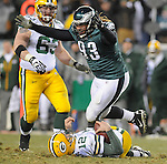 Green Bay Packers quarterback Aaron Rodgers lies on the turf as Philadelphia Eagles defensive tackle Trevor Laws celebrates the sack during the fourth quarter of the Wild Card round playoff game at Lincoln Financial Field in Philadelphia, Penn., on Sunday, Jan. 9, 2011.