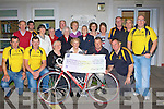Currow Cycling club presents a cheque of EUR13,122.22 to Castleisland Day Care centre last Thursday evening which they raised by holding a fun cycle in Castleisland last September Tom Barrett, Pat Kearney, Maxi Fleming, Monica Prenderville, John Pender, John Breen, Tom Kenny. Back row: David Costello, Adrian Shanahan, Nora Hogan, Joan McCarthy, Donal Nelligan, Sr Maureen, Sheila Greaney, Daisie O'Connor, Maria McCarthy, Joan Walsh, Mike and Dave Fleming...