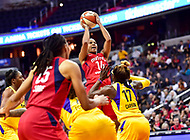 Washington, DC - June 15, 2018: Washington Mystics guard Tierra Ruffin-Pratt (14) shoots a jump shot over Los Angeles Sparks forward Essence Carson (17) during game between the Washington Mystics and Los Angeles Sparks at the Capital One Arena in Washington, DC. (Photo by Phil Peters/Media Images International)