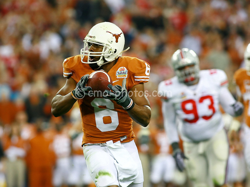 Jan 05, 2009; Glendale, AZ, USA; Texas Longhorns wide receiver Quan Cosby (6) bobbles the bal while making a reception in the second quarter of the Fiesta Bowl against the Ohio State Buckeyes at University of Phoenix Stadium.
