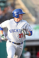 Ryon Healy #27 of the Stockton Ports runs to first base during a game against the Visalia Rawhide at Rawhide Ballpark on May 5, 2014 in Visalia California. Visalia defeated Stockton, 8-6. (Larry Goren/Four Seam Images)