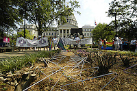 Wire coat hangers stick upside down in the ground outside the Mississippi  State capital in Jackson as part of a protest by NOW. The National Organization for Wqoman held a rally outside the Mississippi State Capital in  Jackson Saturday July 22,2006. NOW is holding a rally in response to Operation Save America that has been protesting all over Jackson, in attempt to close the only abortion clinic in the state of Mississippi. (Photo©Suzi Altman)