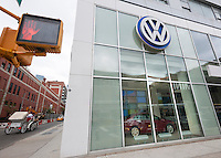 A Volkswagen dealer in Manhattan in New York on Tuesday, September 22, 2015. The U.S. Environmental Protection Agency has alleged that a defeat device built into VW's diesel cars' software will cause the car to appear more environmentally friendly when going through emissions testing. VW faces billions of dollars in fines in the U.S. and potentially other countries, not to mention civil lawsuits. (© Richard B. Levine)