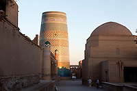 General view of Bir Gumbazli mosque (right), Matniyaz Divanbegi Madrasah (left), Kalta Minar in the background and Ata-Davarza in the distance, Khiva, Uzbekistan, pictured on July 6, 2010 at dawn.