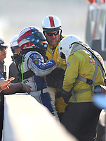 Feb 9, 2018; Pomona, CA, USA; NHRA funny car driver John Force is tended to by Safety Safari rescue crews after an explosion during qualifying for the Winternationals at Auto Club Raceway at Pomona. Force would walk away from the incident. Mandatory Credit: Mark J. Rebilas-USA TODAY Sports