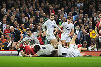 Pictured: Cory Hill of Wales scores his sides first try during the Guinness six nations match between Wales and England at the Principality Stadium, Cardiff, Wales, UK.<br /> Saturday 23 February 2019