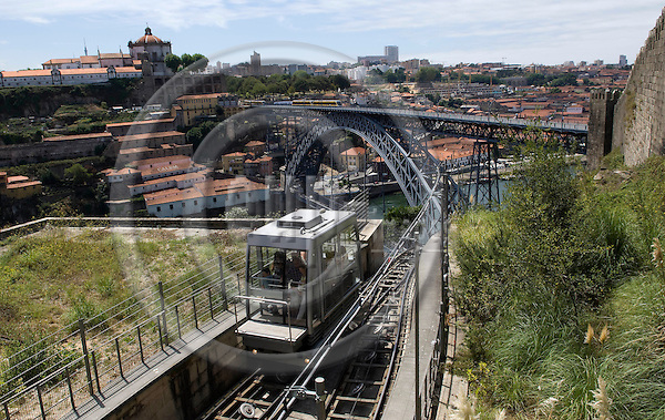 Oporto-Portugal, July 29, 2009 -- Modern funicular railway and steel bridge - Ponte Luis 1. - designed/constructed by Gustave Eiffel over river Rio Douro; architecture, tourism, infrastructure -- Photo: Horst Wagner / eup-images
