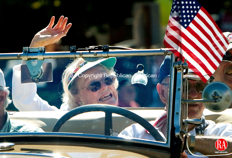 NEWTOWN, CT. 06 September 2010-090610SV03--Grand Marshall Marge Rogers rides in the first division during the 49th annual Labor Day Parade in Newtown Monday. Rogers is a longtime Newtown resident and a member of the Town Players for 47 years.<br /> Steven Valenti Republican-American