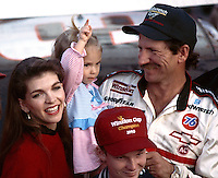 The Earnhardt family celebrates Dale's 1990 Championship at Atlanta.  Left to right:  Teresa, Taylor Nicole, Dale Jr, and Dale Sr. (Photo by Brian Cleary/www.bcpix.com)