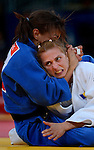 LONDON, ENGLAND - JULY 28:  Sarah Menezes of Brazil submits Alina Dumitru en route to her gold medal in the women's Judo Final during Day 2 of the Swimming Finals as part of the London 2012 Olympic Games on July 28, 2012 at the Excel Center in London, England. (Photo by Donald Miralle)