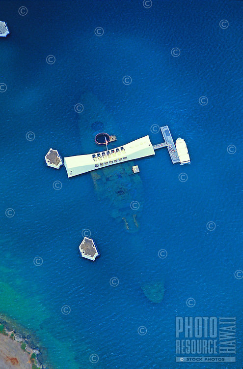 Aerial shot showing a horizontal view of the Arizona Memorial tourist attraction at Pearl Harbor on Oahu. Photo is vertical format.