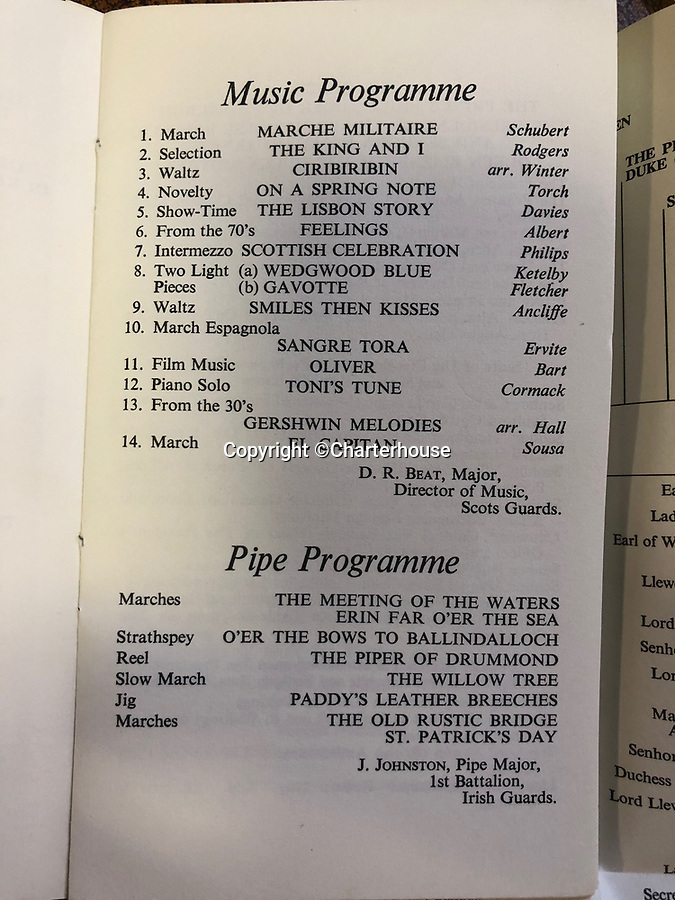 BNPS.co.uk (01202 558833)<br /> Pic: Charterhouse/BNPS<br /> <br /> The musical and Pipe programme for the 1980 state banquet at Buckingham Palace.<br /> <br /> It reveals that esteemed attendees dined on gourmet French cuisine including beef bourgignon which was washed down with a selection of international wines.<br /> <br /> The fascinating archive of a longstanding member of staff to the Royal family has emerged for sale.<br /> <br /> It features a selection of Royal Christmas cards, including one from 2019, as well as a slice of wedding cake and an order of service from Charles and Diana's wedding in 1981.<br /> <br /> The vendor, who wishes to remain anonymous, is also selling their Royal 'personal service' medal and the menu and seat plan for a state banquet in 1980.<br /> <br /> They worked at Buckingham Palace from the late 70s to the beginning of the 21st century, receiving Christmas cards every year since as a token of their service.<br /> <br /> The collection is being sold with Charterhouse Auctioneers, of Sherborne, Dorset. It is expected to fetch £1,500.