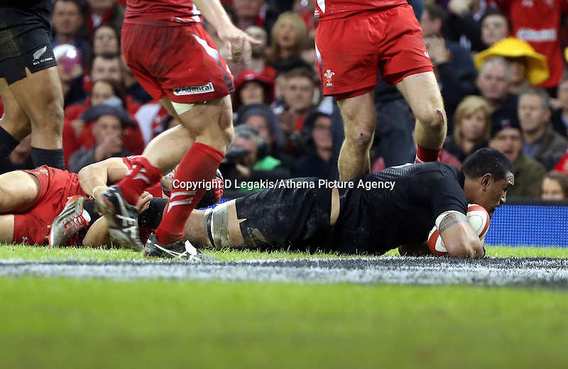 Pictured: Keven Mealamu of New Zealand  scores a try Saturday 22 November 2014<br /> Re: Dove Men Series 2014 rugby, Wales v New Zealand at the Millennium Stadium, Cardiff, south Wales, UK.