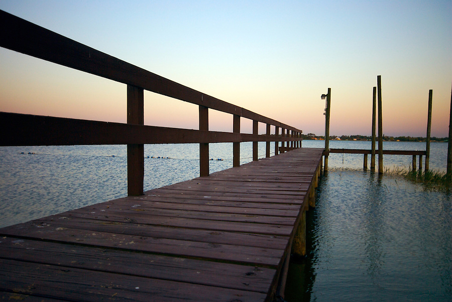 Small boat dock in Lake Grassy Florida at Sunset