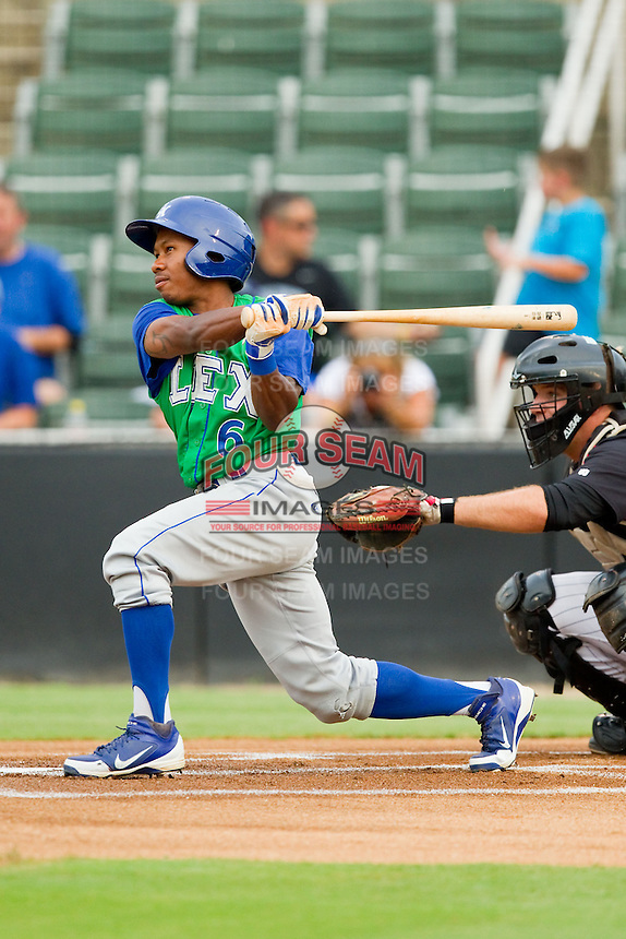 Terrance Gore (6) of the Lexington Legends follows through on his swing against the Kannapolis Intimidators at CMC-Northeast Stadium on July 30, 2013 in Kannapolis, North Carolina.  The Legends defeated the Intimidators 1-0.  (Brian Westerholt/Four Seam Images)
